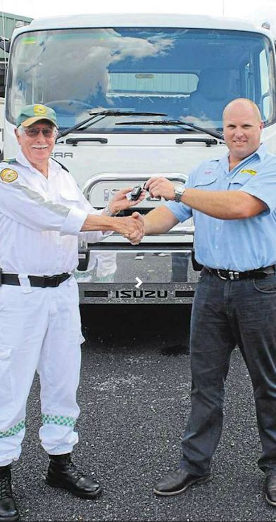 KEYS PLEASE: Mudgee Rescue Squad Captain Brian Wells receives the keys to the Squad's new truck from Tracsery Truck Sales Consultant Daryl French.